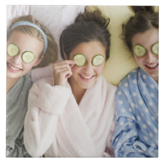 Girls having a facial tile