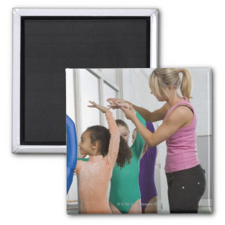 Girls stretching in gymnastics class magnet