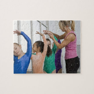 Girls stretching in gymnastics class puzzle