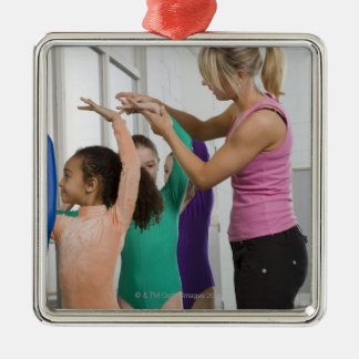 Girls stretching in gymnastics class Silver-Colored square decoration