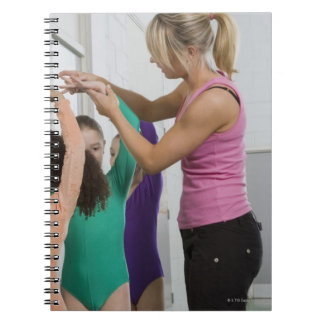 Girls stretching in gymnastics class spiral notebook