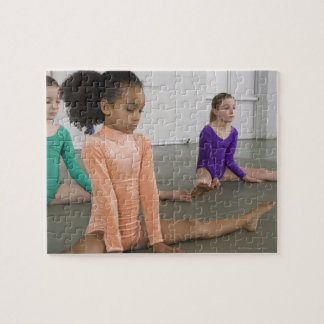Girls stretching in gymnastics practice jigsaw puzzle