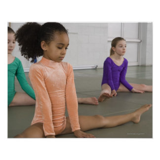 Girls stretching in gymnastics practice poster