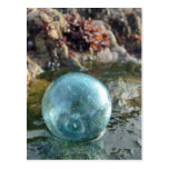 Glass Float on wet sand. Post Card