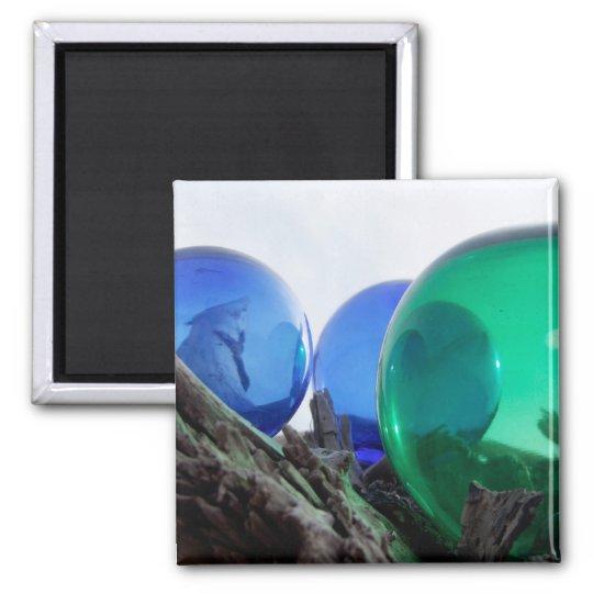Glass floats on grey driftwood magnet