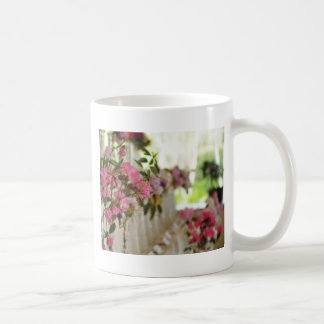 Glass flower vases with spring flowers mugs