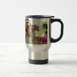 Glass flower vases with spring flowers coffee mug