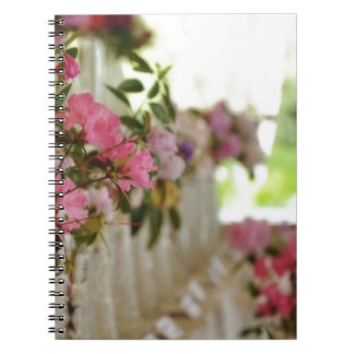 Glass flower vases with spring flowers note books