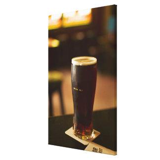 Glass of Irish ale in pub Canvas Print