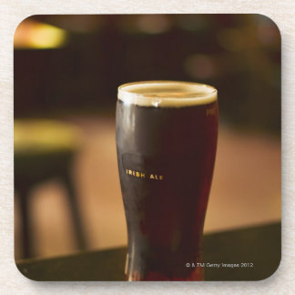 Glass of Irish ale in pub Drink Coaster