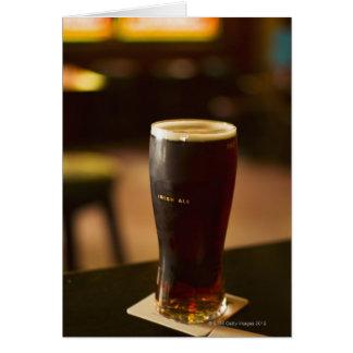 Glass of Irish ale in pub Greeting Card