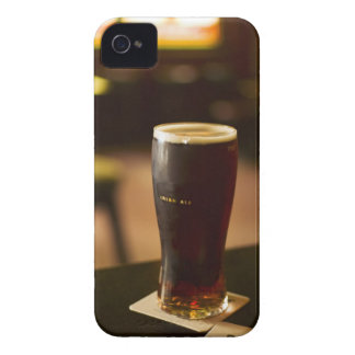 Glass of Irish ale in pub iPhone 4 Covers