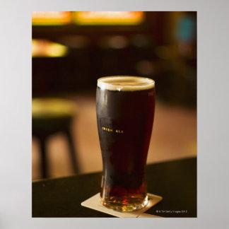 Glass of Irish ale in pub Print