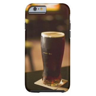 Glass of Irish ale in pub Tough iPhone 6 Case