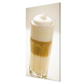 Glass of latte macchiato, close up canvas print