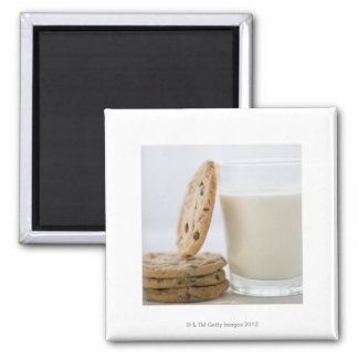 Glass of milk and cookies, close-up magnet
