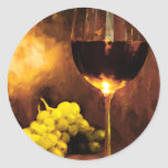Glass of Wine & Green Grapes in Candlelight Round Sticker
