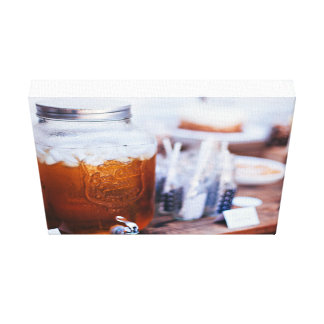 Glass Themed, A Glass Jar Filled With Apple Juice Stretched Canvas Print