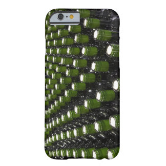 Glass wine bottles in a wine bottling factory. barely there iPhone 6 case