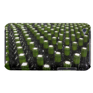 Glass wine bottles in a wine bottling factory. iPod touch covers