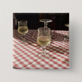 Glasses for water and wine on outdoor red 15 cm square badge