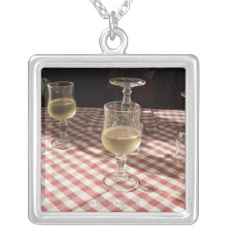 Glasses for water and wine on outdoor red silver plated necklace