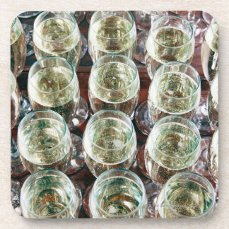 Glasses of Champagne on a table at a celebration Coaster