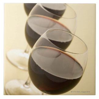 Glasses of red wine tile