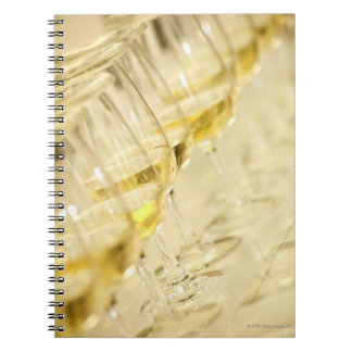 Glasses of white wine for wine tasting, close up notebook