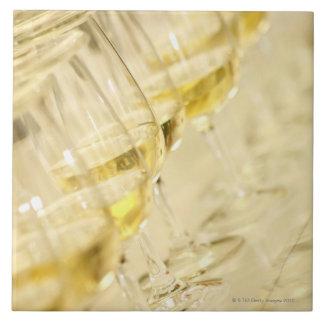 Glasses of white wine for wine tasting, close up tile