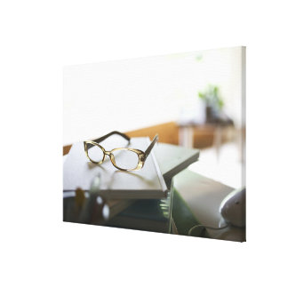 Glasses on the book canvas print