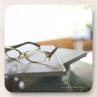 Glasses on the book beverage coasters