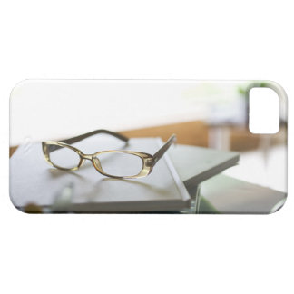 Glasses on the book iPhone 5 cases