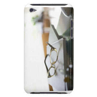 Glasses on the book iPod touch cover