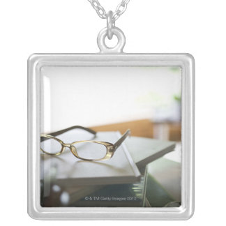 Glasses on the book square pendant necklace