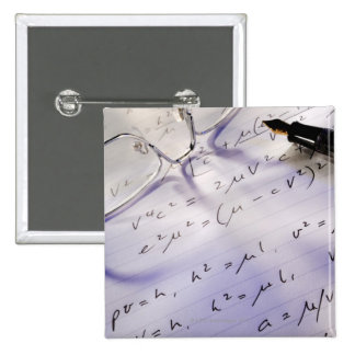 Glasses, pen and mathematical symbols on paper, 15 cm square badge