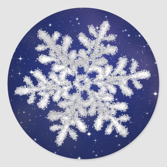 Glittering silver white snowflake on night sky round