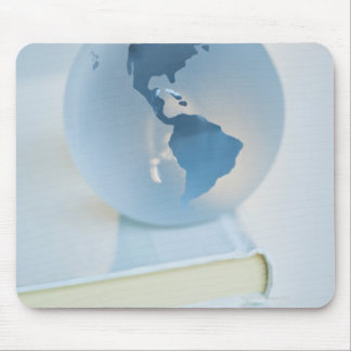 Globe on a book mouse pad