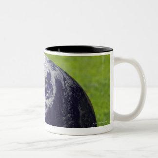 Globe on lawn 3 mug