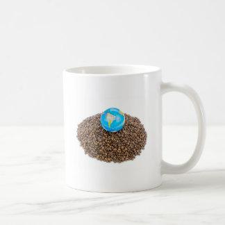 Globe with world on heap of whole coffee beans basic white mug