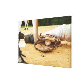 Glove of baseball player tagging runner out, canvas print