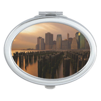 Glow of sunset during stormy skies over East Compact Mirror