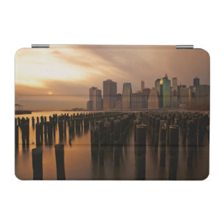 Glow of sunset during stormy skies over East iPad Mini Cover