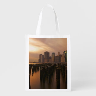 Glow of sunset during stormy skies over East Reusable Grocery Bag