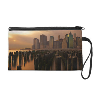 Glow of sunset during stormy skies over East Wristlet Clutch