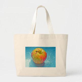 Glowing Apple Tote Bags