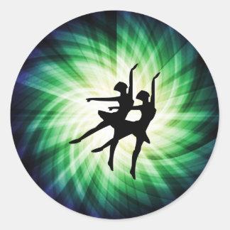 Glowing Ballerinas Round Sticker