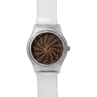 Glowing Golden Fractal Explosion on Burgundy Watches