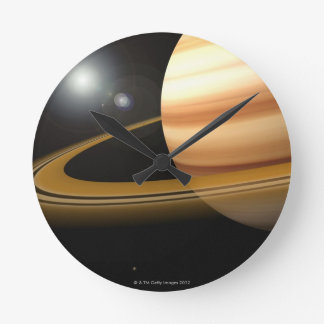 Glowing Stars and a Moon of Saturn Wall Clock