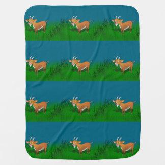 Goat in long grass receiving blankets